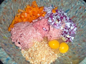ground meat, chopped onion and pepper, eggs, bread crumbs