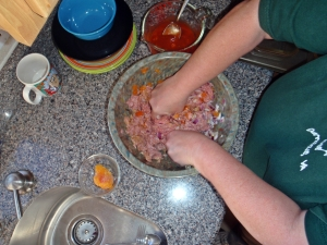 Mixing the meatloaf ingredients